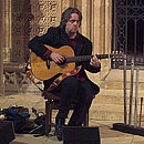 Troy playing the acoustic guitar at Lincoln Cathedral